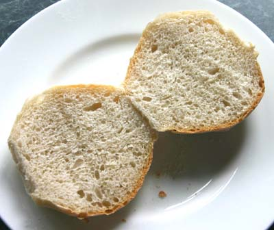 The same roll split to show the                 crumb structure