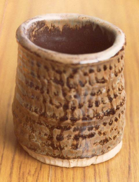 A coiled pot in tenmoku and oatmeal